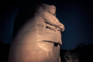 MLK statue at night